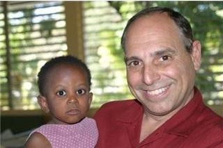 Trinity Member Frank with Haiti child on Mission Trip in 2008